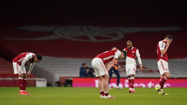 Arsenal's players appear dejected after the final whistle