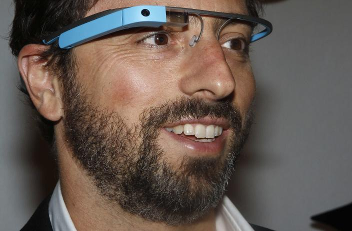 Google Inc. co-founder Sergey Brin poses for a portrait wearing Google Glass glasses before the Diane von Furstenberg Spring/Summer 2013 collection show during New York Fashion Week in this September 9, 2012 file photo. On November 9, 2014, Brin, who previously never missed a high-profile opportunity to sport Google Glass, sauntered bare-faced into a Silicon Valley red-carpet event, telling a reporter he had left his pair in the car. To match Insight GOOGLE-GLASS/ REUTERS/Carlo Allegri/Files (UNITED STATES - Tags: FASHION SCIENCE TECHNOLOGY BUSINESS PROFILE)