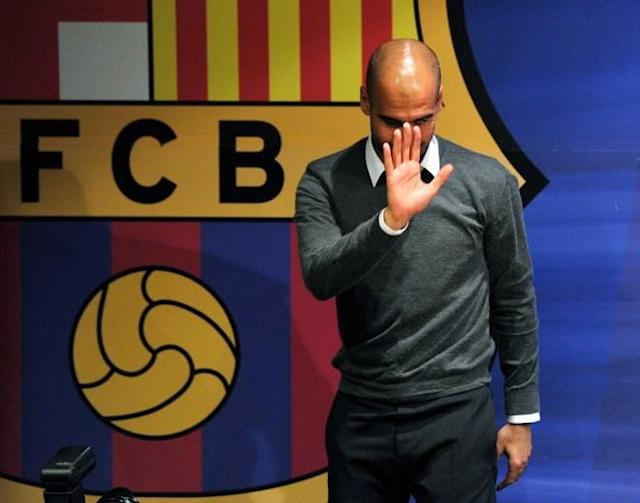 Barcelona's coach Josep Guardiola gestures during a press conference in Barcelona on April 27, 2012. Barcelona coach Pep Guardiola announced today he is leaving the club at the end of the season, ending a four-year reign over one of the greatest eras in club football. TOPSHOTS AFP PHOTO / LLUIS GENELLUIS GENE/AFP/GettyImages