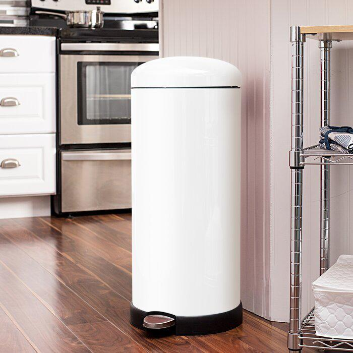 """<p>Believe it or not, this trash can has a cult following. With pretty powder-coated steel, this <a href=""""https://www.marthastewart.com/shop/martha-exclusives/martha-stewart-kitchen-essentials-sc281474979922971.html"""" rel=""""nofollow noopener"""" target=""""_blank"""" data-ylk=""""slk:kitchen staple"""" class=""""link rapid-noclick-resp"""">kitchen staple</a> boasts a round, retro shape and removable inner bucket that's made it a designer and blogger favorite for years.</p> <p><strong><em>Shop Now: </em></strong><em>Honey Can Do White Retro Kitchen Step-on Trash Can, $89.99, <a href=""""https://www.anrdoezrs.net/links/9104911/type/dlg/sid/MSLTheseEfficientSleekTrashCansWillUpgradeYourKitchenameyerKitGal7984490202009I/https://www.wayfair.com/school-furniture-and-supplies/pdx/honey-can-do-retro-kitchen-step-on-trash-can-hcd3711.html"""" rel=""""nofollow noopener"""" target=""""_blank"""" data-ylk=""""slk:wayfair.com"""" class=""""link rapid-noclick-resp"""">wayfair.com</a>.</em></p>"""