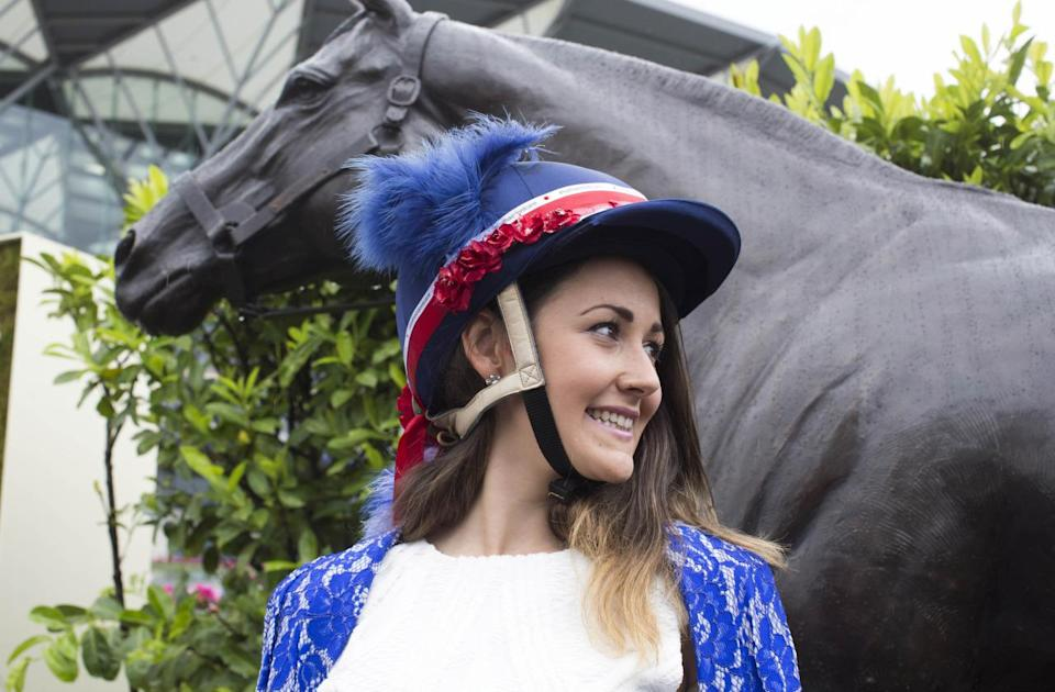 Lucy Comm goes patriotic with an embellished hard hat. [Photo: Rex]