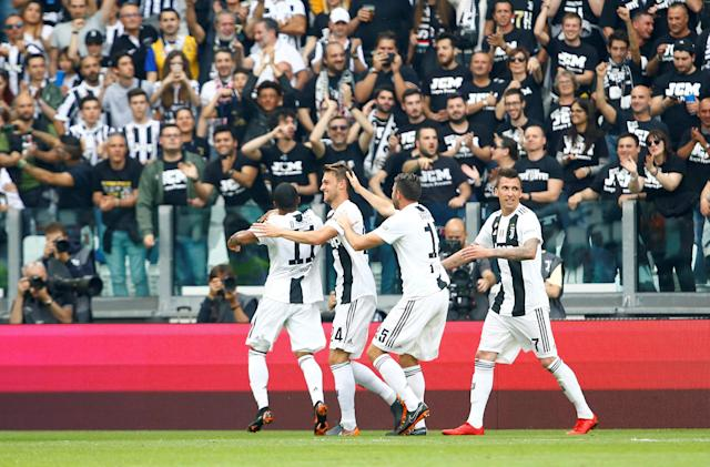 Soccer Football - Serie A - Juventus vs Hellas Verona - Allianz Stadium, Turin, Italy - May 19, 2018 Juventus' Daniele Rugani celebrates scoring their first goal with Douglas Costa and team mates REUTERS/Stefano Rellandini