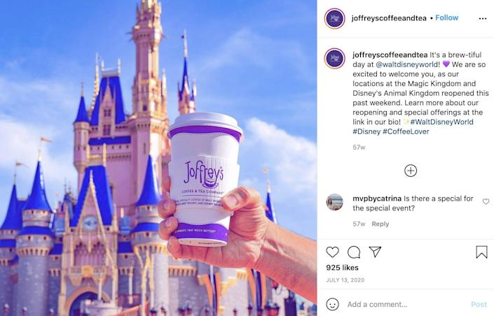 A person holding a coffee cup with Joffrey's Coffee And Tea logo on it in front of the castle at Disney World in Florida.