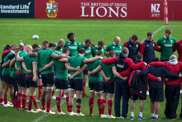<p>British and Irish Lions squad members embrace for a moment of silence for the victims in the London terror attacks prior to a training run in Auckland, New Zealand, Tuesday, June 6, 2017. The Lions play the Auckland Blues in their second tour match at Eden park Wednesday June 7. (Photo: Brett Phibbs/New Zealand Herald via AP) </p>