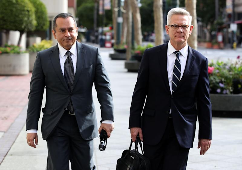 SAN JOSE, CALIFORNIA - JANUARY 14: Former Theranos COO Ramesh Balwani (L) leaves the Robert F. Peckham U.S. Federal Court with his attorney on January 14, 2019 in San Jose, California. Former Theranos CEO Elizabeth Holmes and former COO Ramesh Balwani appeared in federal court facing charges of conspiracy and wire fraud for allegedly engaging in a multimillion-dollar scheme to defraud investors with the Theranos blood testing lab services. (Photo by Justin Sullivan/Getty Images)