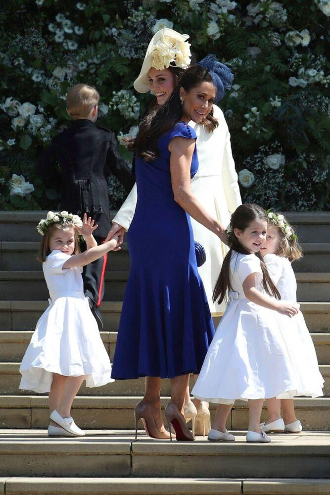 Jessica Mulroney and daughter Ivy (center) with Kate Middleton and Princess Charlotte (left) at Harry and Meghan's wedding. | Jane Barlow/AP/REX/Shutterstock