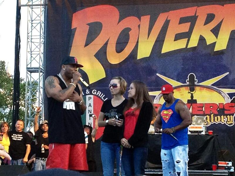 In this Saturday, July 27, 2013, photo provided by Brian Harrell, Amanda Berry, one of three women held captive in a Cleveland home for a decade, makes a surprise appearance at the RoverFest concert in Cleveland. Berry appeared at a public event for the first time since her rescue, a day after her abductor pleaded guilty in the case. The rapper Nelly called Berry back to the stage after his music set. (AP Photo/Courtesy Brian Harrell)