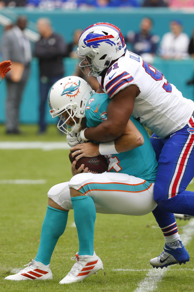 Buffalo Bills defensive tackle Ed Oliver (91) sacks Miami Dolphins quarterback Ryan Fitzpatrick (14), during the first half at an NFL football game, Sunday, Nov. 17, 2019, in Miami Gardens, Fla. (AP Photo/Wilfredo Lee)