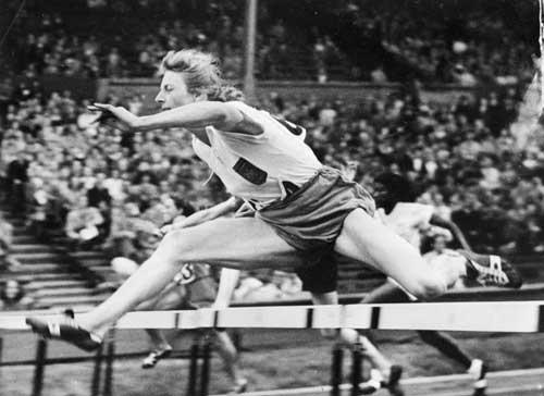 Blankers-Koen competing in the hurdles at the 1948 London Games (Getty)