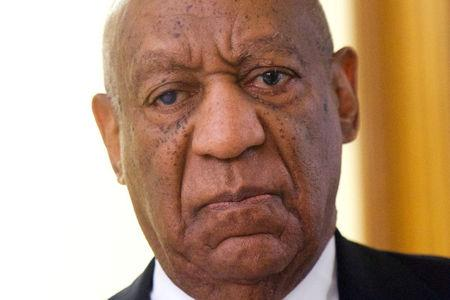 FILE PHOTO:    Cosby reacts while being notified a verdict is in at the Montgomery County Courthouse in his sexual assault retrial in Norristown