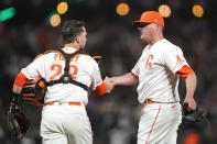 San Francisco Giants catcher Buster Posey, left, celebrates with pitcher Jake McGee after the Giants defeated the Los Angeles Dodgers 2-1 in a baseball game in San Francisco, Tuesday, July 27, 2021. (AP Photo/Jeff Chiu)