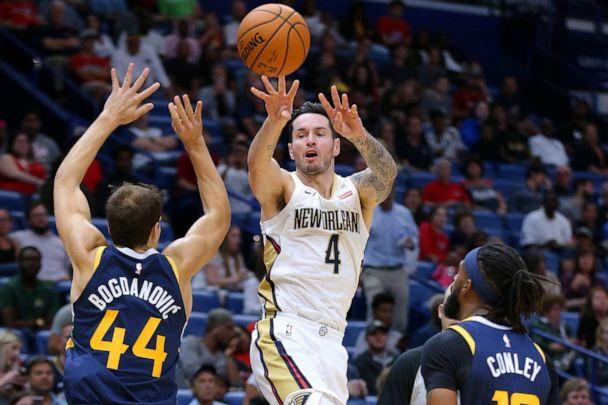 PHOTO: JJ Redick of the New Orleans Pelicans passes around Bojan Bogdanovic of the Utah Jazz during the second half of a game, Oct. 11, 2019 in New Orleans. (Jonathan Bachman/Getty Images, FILE)