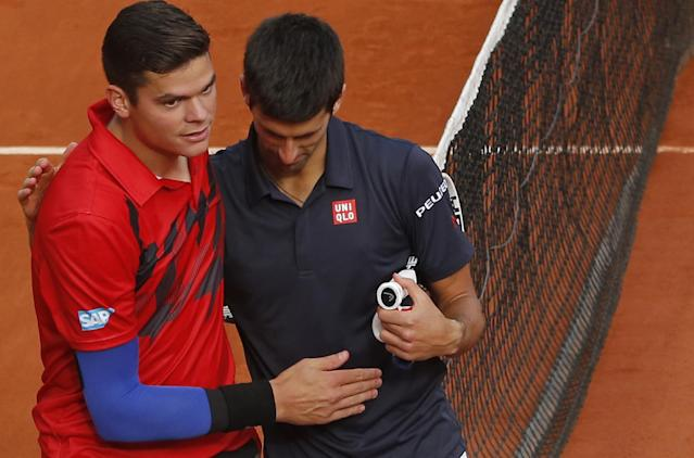 Canada's Milos Raonic, left, congratulates Serbia's Novak Djokovic, right, after the quarterfinal match of the French Open tennis tournament against at the Roland Garros stadium, in Paris, France, Tuesday, June 3, 2014. Djokovic won in three sets 7-5, 7-6, 6-4. (AP Photo/Michel Euler)