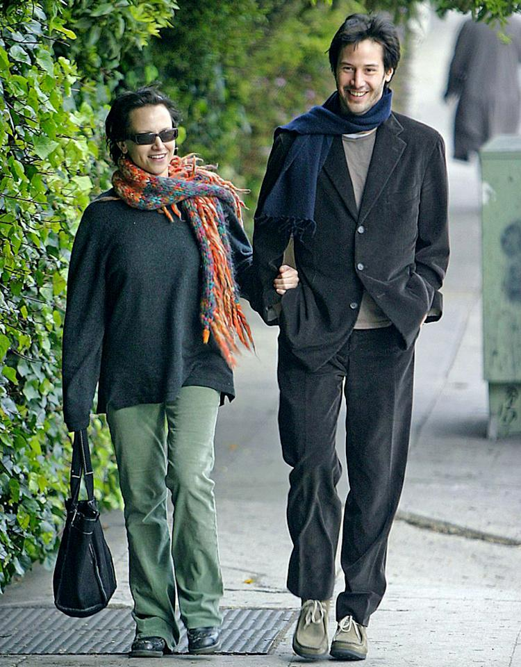 "6541 HOLLYWOOD, CALIFORNIA.  Thursday February 19 2004. EXCLUSIVE: ""Matrix"" star Keanu Reeves spends some precious time with his sister Kim. The siblings went to see Bernardo Bertolucci's new film ""The Dreamers"" but left after just 30 minutes. Kim, 38, held on to Keanu's arm as they walked back to his car. Kim is suffering from leukaemia and reportedly spends most of her time on the Italian island of Capri. Photograph: Andrew ShawafPacificcoastnews.com***FEE MUST BE AGREED PRIOR TO USAGE ***UK OFFICE:  44 131 225 3333/3322US OFFICE: 1 310 261 9676"