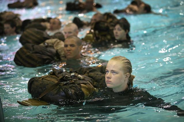 PARRIS ISLAND, SC - FEBRUARY 25: Male and Female Marine recruits haul backpacks while swimming in their uniforms as they are tested to determine their swimming skills during boot camp February 25, 2013 at MCRD Parris Island, South Carolina. Male and female recruits are expected to meet the same standards during their swim qualification test. All female enlisted Marines and male Marines who were living east of the Mississippi River when they were recruited attend boot camp at Parris Island. About six percent of enlisted Marines are female. (Photo by Scott Olson/Getty Images)