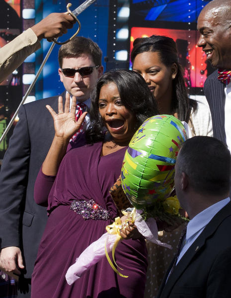 """Oscar-winning actress Octavia Spencer, center, arrives at the Alabama Statehouse in Montgomery, Ala., Wednesday, March 21, 2012. Spencer was greeted by more than 400 people as she arrived at the Statehouse to a hero's welcome. Earlier this year, Spencer won a best supporting actress Oscar for her performance in """"The Help."""" (AP Photo/Dave Martin)"""