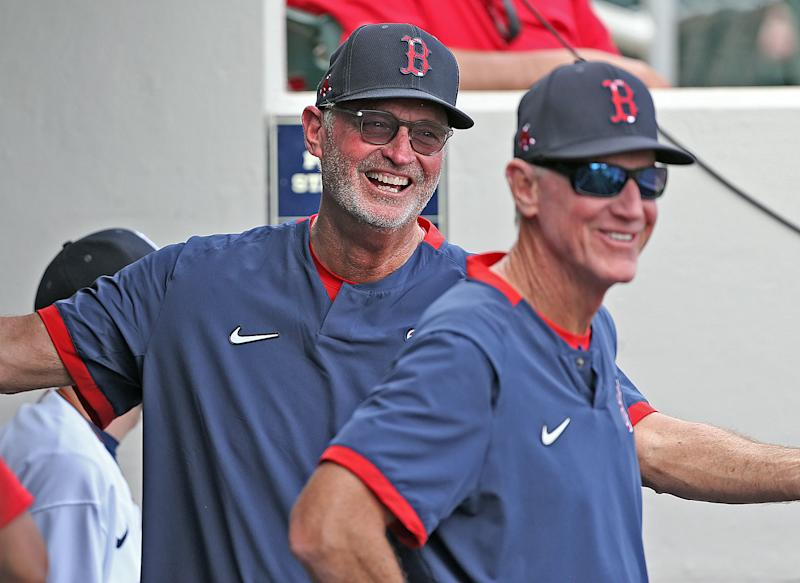 FORT MYERS, FL. - FEBRUARY 24: Boston Red Sox bench coach Jerry Narron laughs with manager Ron Roenicke in the dugout during a spring training game against the Minnesota Twins at Hammond Stadium on February 24, 2020 in Fort Myers, Florida. (Staff Photo By Matt Stone/MediaNews Group/Boston Herald)
