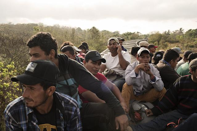 <p>A group of Central American refugees and asylum seekers, led by the non-profit humanitarian organization Pueblos Sin Fronteras (People Without Borders), ride 'The Beast' freight train in Matias Romero, Oaxaca state, Mexico, on Sunday, April 1, 2018. The Trump administration is crafting legislation to make it harder for refugees to gain asylum in the U.S. and loosen restrictions on detaining immigrants apprehended near the border, a senior White House official said. (Photo: Jordi Ruiz Cirera/Bloomberg via Getty Images) </p>