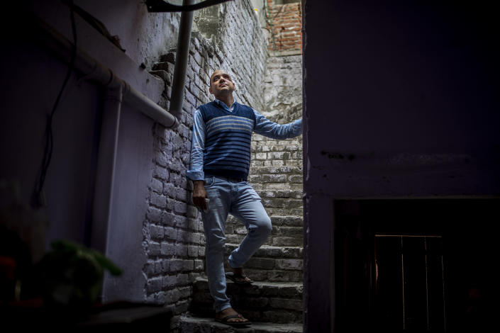 Muhammad Nasir Khan, who was shot by a Hindu mob during the February 2020 communal riots, is seen inside his home in North Ghonda, one of the worst riot affected neighborhood, in New Delhi, India, Friday, Feb. 19, 2021. As the first anniversary of bloody communal riots that convulsed the Indian capital approaches, Muslim victims are still shaken and struggling to make sense of their struggle to seek justice. (AP Photo/Altaf Qadri)