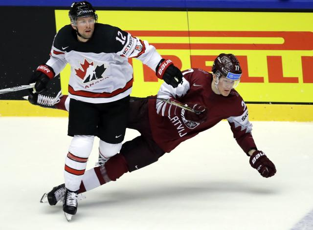 Ice Hockey - 2018 IIHF World Championships - Group B - Canada v Latvia - Jyske Bank Boxen - Herning, Denmark - May 14, 2018 - Josh Bailey of Canada in action with Kristaps Zile of Latvia. REUTERS/David W Cerny