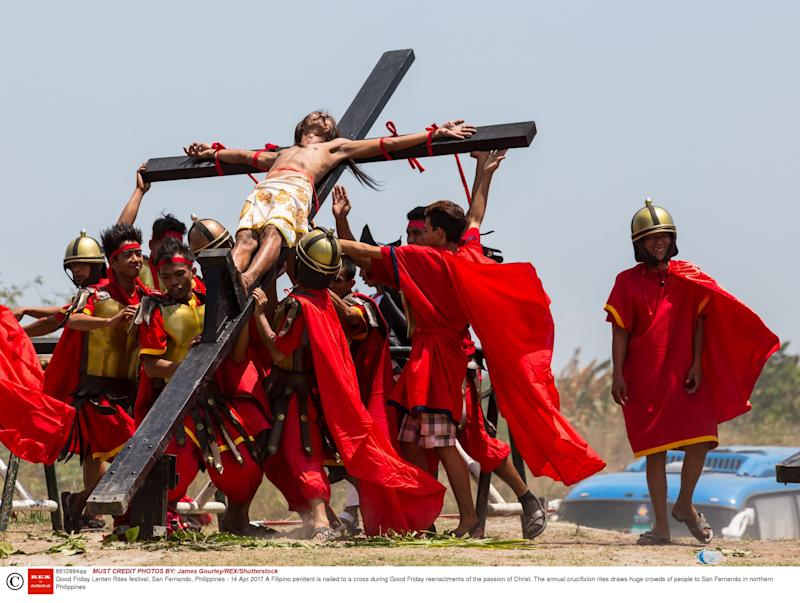 A Filipino penitent is nailed to a cross during Good Friday reenactments of the passion of Christ - Credit: James Gourley/REX/Shutterstock