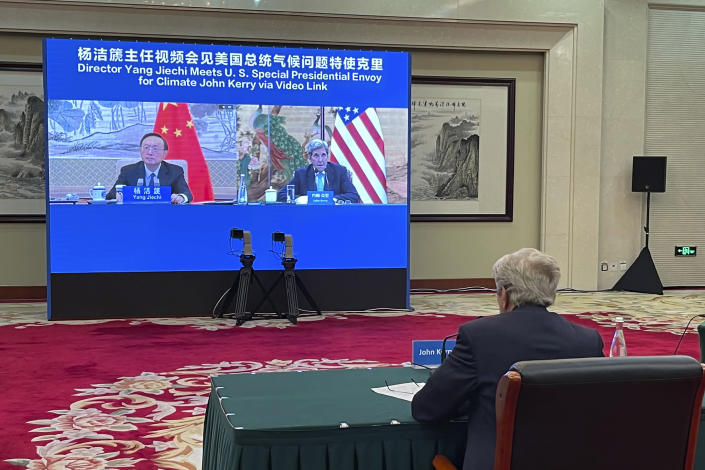 FILE - In this Sept. 2, 2021, file photo provided by the U.S. Department of State, U.S. Special Presidential Envoy for Climate John Kerry attends a meeting with Yang Jiechi, director of China's Office of the Central Commission for Foreign Affairs, via video link in Tianjin, China. Kerry came to China seeking to press the world's largest emitter of greenhouse gases to do more in the global effort to hold down the rise in temperature. What he got was renewed demands for Washington to change its stance toward China on a host of other issues from human rights to Taiwan. (U.S. Department of State via AP, File)