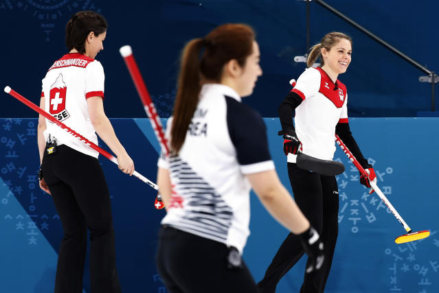 <p>Switzerland's skip Silvana Tirinzoni, right, smiles after winning against Russian athletes at the women's curling match at the 2018 Winter Olympics in Gangneung, South Korea, Monday, Feb. 19, 2018. (AP Photo/Aaron Favila) </p>