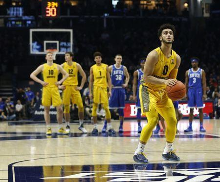 Jan 26, 2019; Cincinnati, OH, USA; Marquette Golden Eagles guard Markus Howard (0) shoots a free throw during the second half against the Xavier Musketeers at the Cintas Center. Mandatory Credit: Frank Victores-USA TODAY Sports