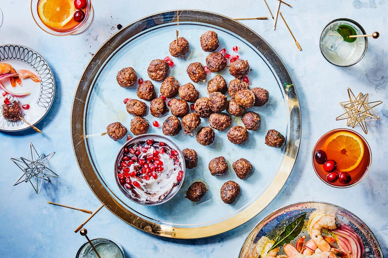 """These Turkish meatballs are so juicy, light, and flavorful—not to mention easy—they'll be the star of any cocktail party you host. The yogurt sauce is extra pretty, thanks to a cup of tart pomegranate juice and a sprinkle of fresh pomegranate arils. <a href=""""https://www.epicurious.com/recipes/food/views/turkish-spiced-meatballs-with-pomegranate-yogurt-sauce-51142260?mbid=synd_yahoo_rss"""">See recipe.</a>"""