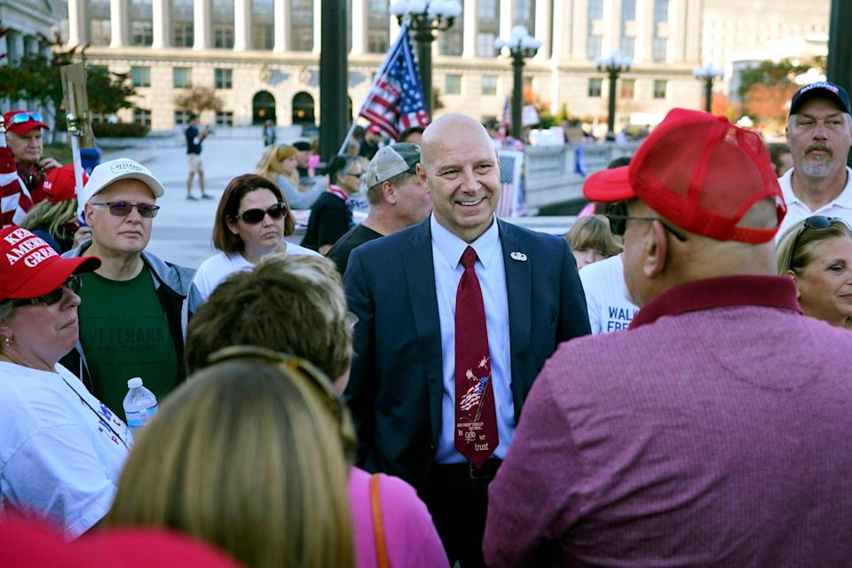 Pennsylvania state Sen. Doug Mastriano, R-Franklin, center, speaks to supporters of President Donald Trump as they demonstrate outside the Pennsylvania State Capitol, Saturday, Nov. 7, 2020, in Harrisburg, Pa.