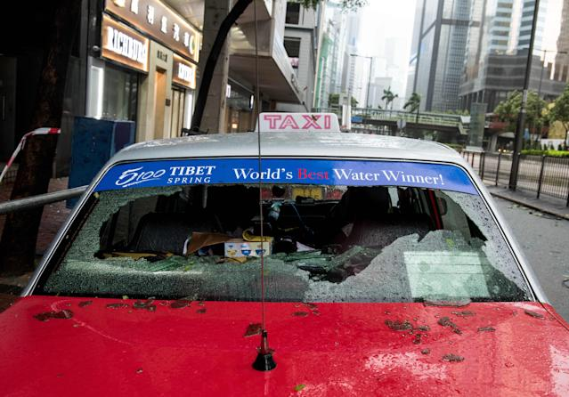 <p>Two taxis have their back windows knocked out by falling windows from an office building in Causeway Bay as Typhoon Hato hits land in Hong Kong causing a signal 10 Tropical cyclone on Aug. 23, 2017. (Photo: Jayne Russell via ZUMA Wire) </p>