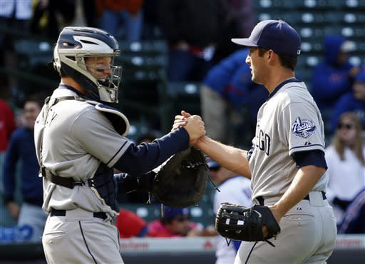 San Diego Padres catcher Nick Hundley, left, celebrates with relief pitcher Huston Street after their 4-2 win over the Chicago Cubs after a baseball game, Thursday, May 2, 2013, in Chicago. (AP Photo/Charles Rex Arbogast)