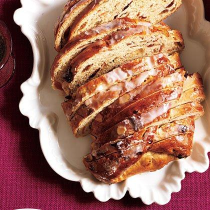 """<p>Jewel-like brandy-soaked fruit in an enriched dough–this bread is a joyous celebration of the season. </p><p><a href=""""https://www.myrecipes.com/recipe/christmas-stollen"""">Christmas Stollen Recipe</a></p>"""