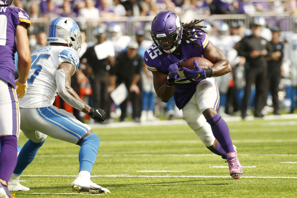 Minnesota Vikings running back Alexander Mattison runs from Detroit Lions safety Will Harris, left, during a 15-yard touchdown reception during the first half of an NFL football game, Sunday, Oct. 10, 2021, in Minneapolis. (AP Photo/Bruce Kluckhohn)