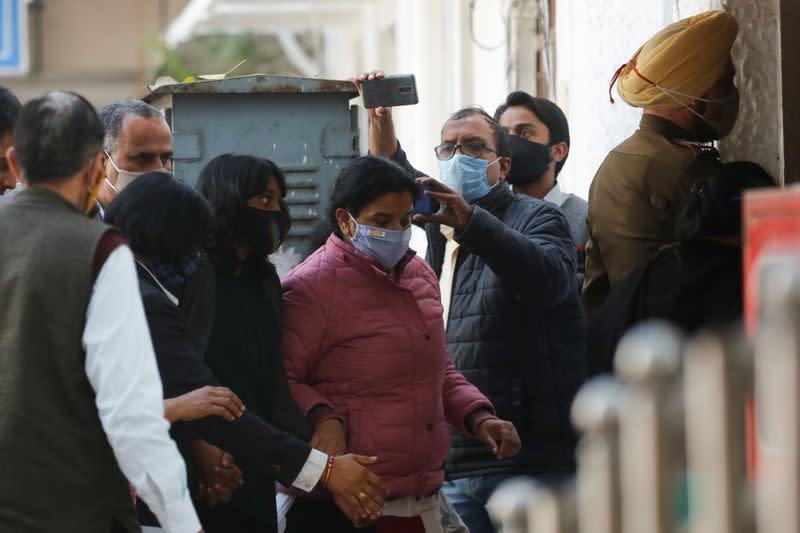 Disha Ravi, a 22-year-old climate activist, arrives to a court in New Delhi