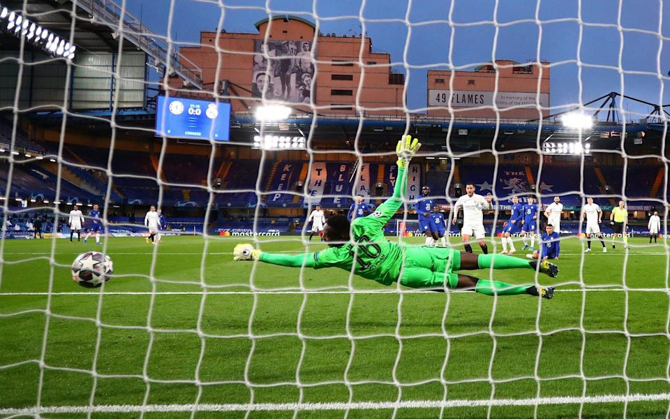 Edouard Mendy of Chelsea makes a save during the UEFA Champions League Semi Final Second Leg match between Chelsea and Real Madrid at Stamford Bridge on May 05, 2021 in London, England. Sporting stadiums around Europe remain under strict restrictions due to the Coronavirus Pandemic as Government social distancing laws prohibit fans inside venues resulting in games being played behind closed doors - Clive Rose/Getty Images