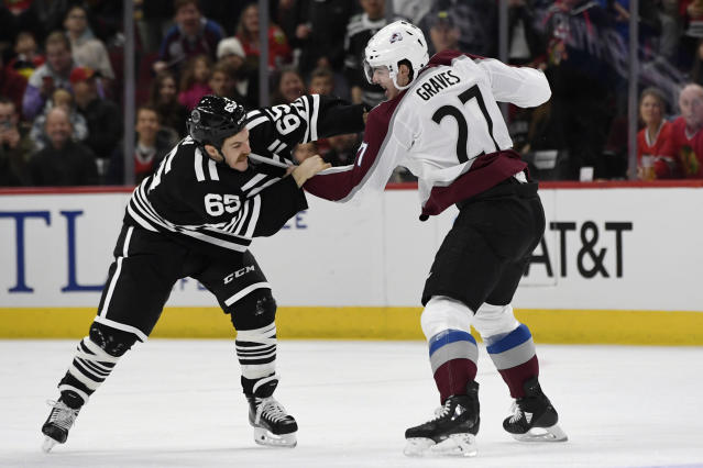 Chicago Blackhawks' Andrew Shaw (65) fights Colorado Avalanche's Ryan Graves (27) during the first period of an NHL hockey game Friday, Nov. 29, 2019, in Chicago. (AP Photo/Paul Beaty)