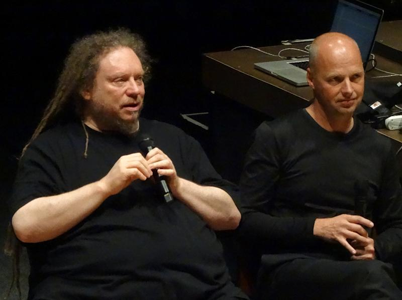 Sebastian Thrun (R), the founder of the Google X research library, looks on as virtual reality pioneer Jaron Lanier speaks at a symposium at Stanford University in Palo Alto, California on April 2, 2015