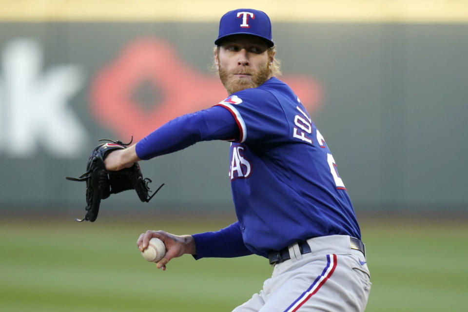 Texas Rangers starting pitcher Mike Foltynewicz winds up during the second inning of the team's baseball game against the Seattle Mariners on Saturday, May 29, 2021, in Seattle. (AP Photo/Elaine Thompson)