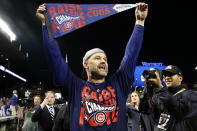FILE - In this Oct. 22, 2016 file photo, Chicago Cubs catcher David Ross celebrates after Game 6 of the National League baseball championship series against the Los Angeles Dodgers, in Chicago. The Chicago Cubs have hired former catcher David Ross to replace Joe Maddon as their manager, hoping he can help them get back to the playoffs after missing out for the first since 2014. (AP Photo/Nam Y. Huh, File)