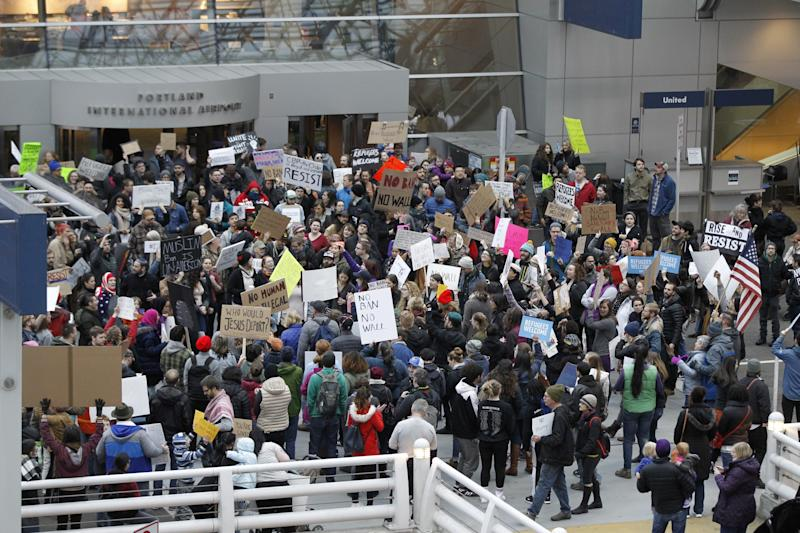 Activists gather at Portland International Airport in Oregon to protest Trump's initial travel ban on Jan. 29. (Steve Dipaola / Reuters)