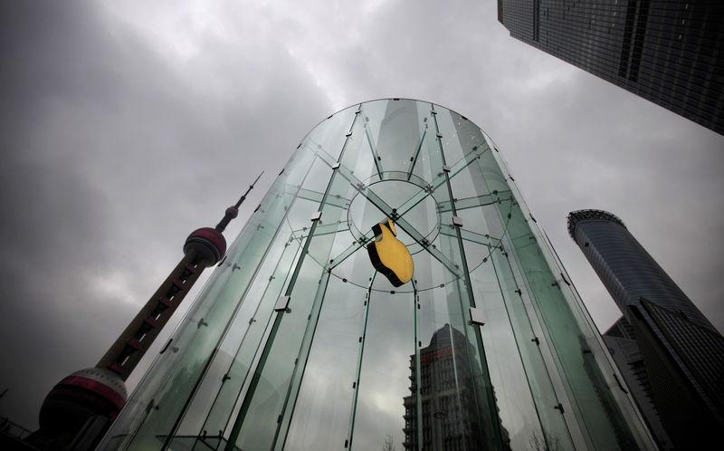 FILE PHOTO: An Apple logo is seen at an Apple store in Pudong, the financial district of Shanghai, China