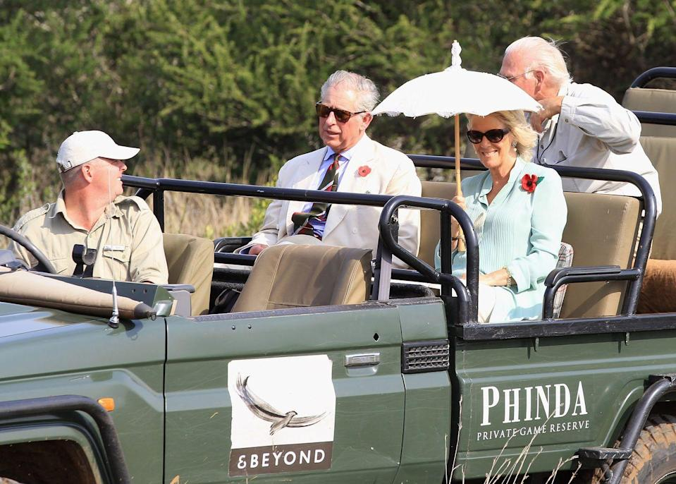 <p>Prince Charles and Camilla went on a safari in South Africa's Phinda Game Reserve where they spotted...wait for it...rhinos. The couple was visiting South Africa before heading to Tanzania. </p>