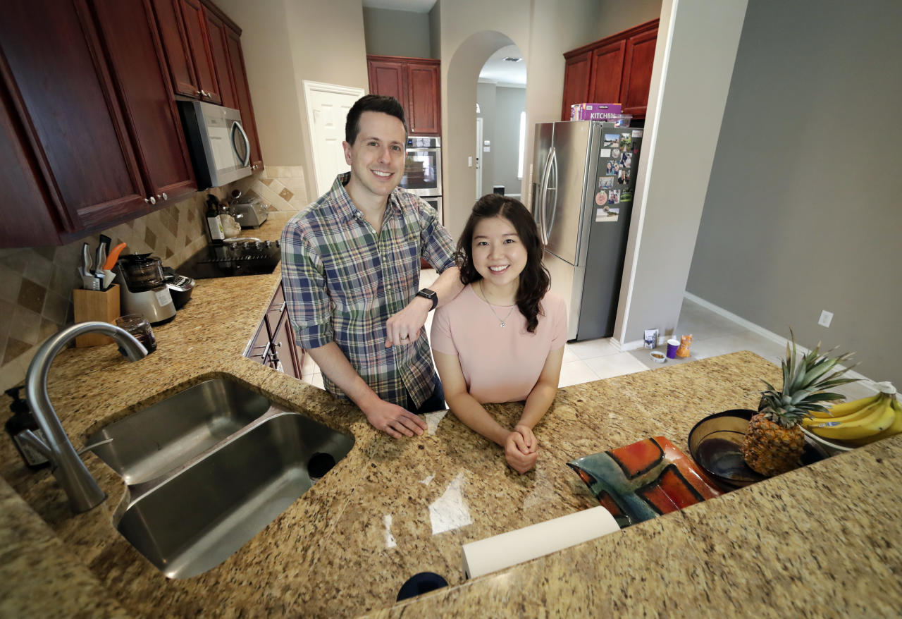 <p> In this April 9, 2018, photo, Rob Chilton and his wife Saria pose for a photo in their recently purchased home in Frisco, Texas. To cope with rising prices in Dallas, first-time buyers like Rob Chilton and his wife have broadened their search area, even if it lengthens their commutes to work. The couple, who cut back on dining out and other luxuries the past few years to set aside money for a down payment, bought a three-bedroom, two-bath fixer-upper for $335,000 in February. (AP Photo/Tony Gutierrez) </p>