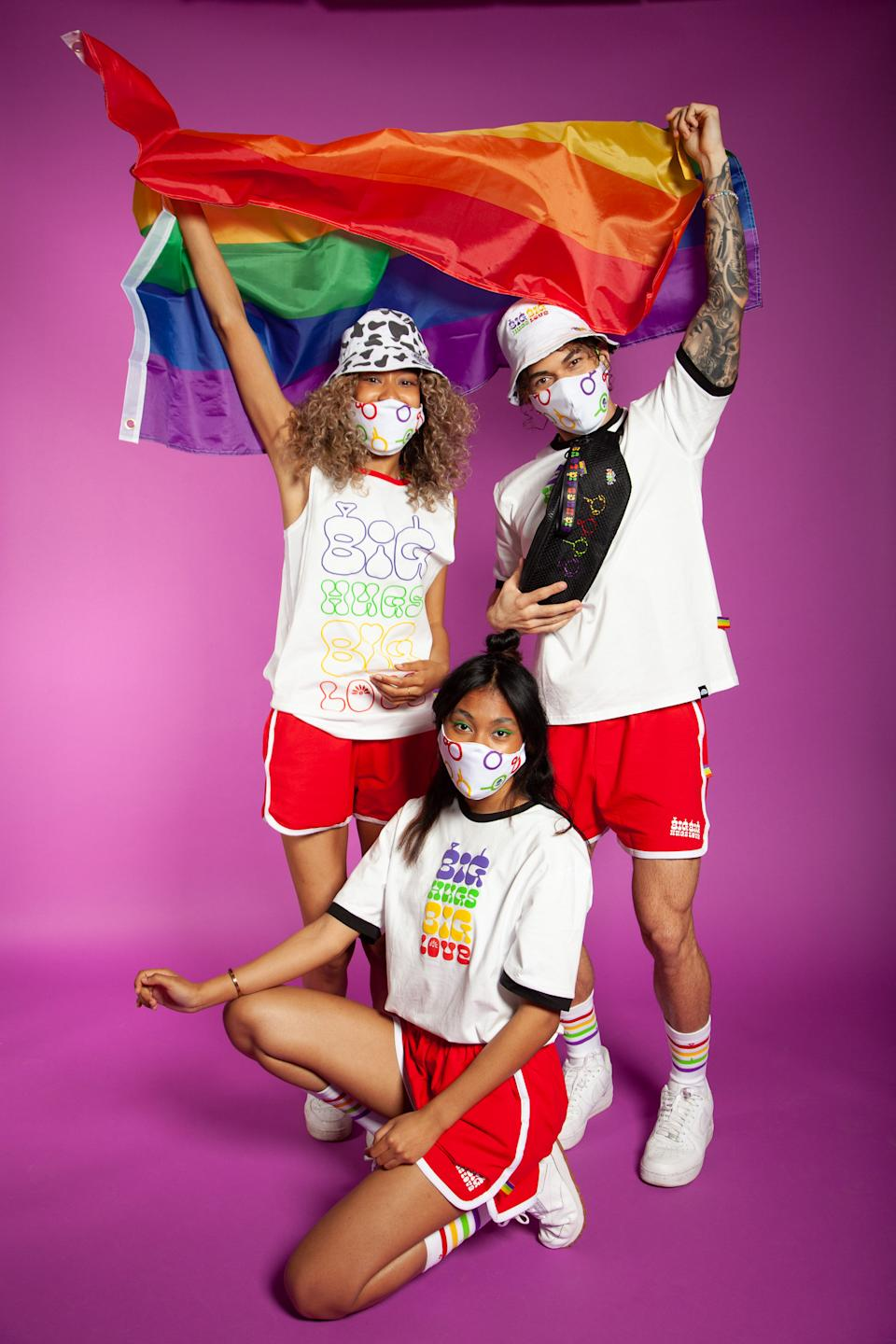 Models pile on some of the new Pride merch — rainbow tube socks, statement tees, red shorts, bucket hats and fanny packs. (Photo courtesy of Teletubbies Pride Collection)