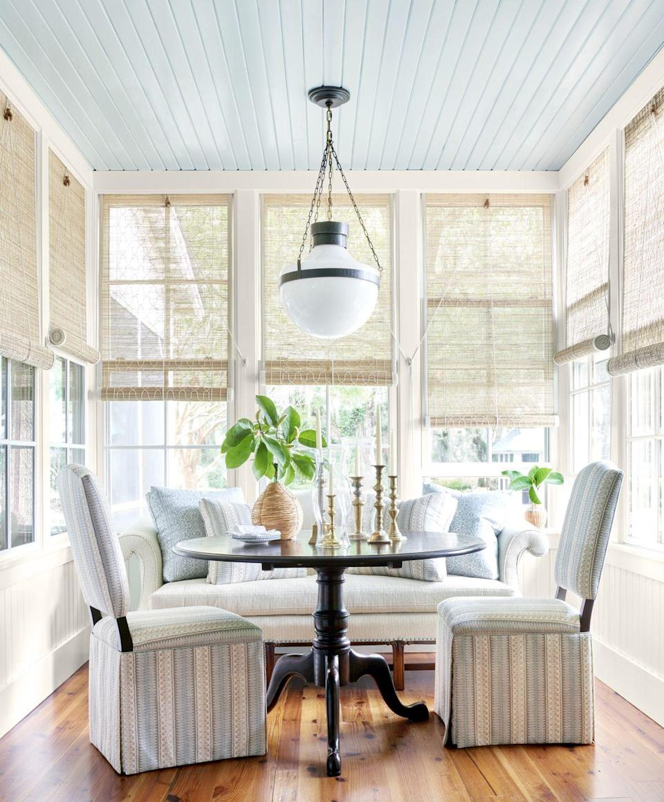 """<p>In the South, legend has it that a light blue ceiling on the front porch brings good luck to those who live inside. In this South Carolina river home, a dining room mimics the same effect with a ceiling painted in <a href=""""https://www.sherwin-williams.com/homeowners/color/find-and-explore-colors/paint-colors-by-family/SW9136-lullaby"""" rel=""""nofollow noopener"""" target=""""_blank"""" data-ylk=""""slk:Lullaby by Sherwin-Williams"""" class=""""link rapid-noclick-resp"""">Lullaby by Sherwin-Williams</a>. <br></p>"""