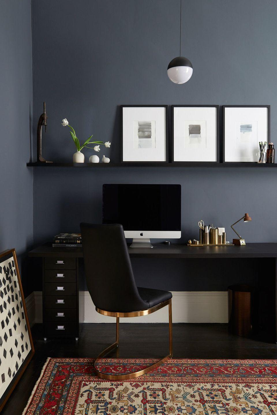 """<p>Is this not the sexiest office you've ever seen? Black furniture combined with brass accents looks super sleek. Opt for a gray-black for the walls, so it doesn't feel too dark. </p><p>Photo by <a href=""""http://www.nicolefranzen.com/interiors/"""" rel=""""nofollow noopener"""" target=""""_blank"""" data-ylk=""""slk:Nicole Franzen"""" class=""""link rapid-noclick-resp"""">Nicole Franzen</a>.</p>"""
