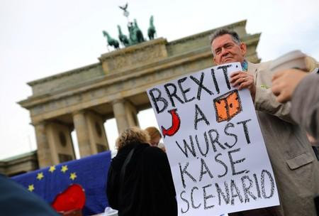 """A demonstrator holds a sign during a rally under the slogan """"Stop the Coup"""" to protest against attempts to force through a no-deal Brexit, in Berlin"""