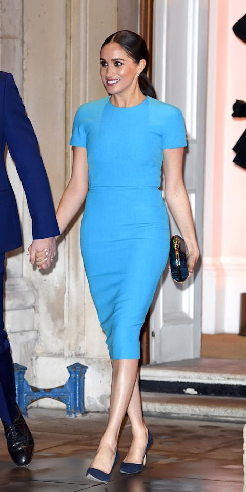 """<p>Hopefully Meghan Markle knows that her dress is not just blue, it's not turquoise, and it's not lapis. It's actually cerulean. And if she doesn't, well, no one tell Meryl Streep. At the Endeavor Fund Awards in London, Markle reminded us of the iconic <em>Devil Wears Prada </em>scene by wearing a cerulean midi dress by Victoria Beckham (<strong>Shop similar:</strong> $895; <a href=""""https://click.linksynergy.com/deeplink?id=93xLBvPhAeE&mid=1237&murl=https%3A%2F%2Fshop.nordstrom.com%2Fs%2Fsies-marjan-andy-cowl-neck-satin-a-line-midi-dress%2F5538977%2Ffull%3F&u1=IS%2CLOTD-MeghanMarkle-Slide%2Ckchiello1271%2C%2CIMA%2C3528368%2C202003%2CI"""" target=""""_blank"""">nordstrom.com</a>) with navy Manolo pumps (<strong>Shop now:</strong> $625; <a href=""""https://click.linksynergy.com/deeplink?id=93xLBvPhAeE&mid=1237&murl=https%3A%2F%2Fshop.nordstrom.com%2Fs%2Fmanolo-blahnik-bb-pointy-toe-pump-women%2F3209276%2Ffull%3F&u1=IS%2CLOTD-MeghanMarkle-Slide%2Ckchiello1271%2C%2CIMA%2C3528368%2C202003%2CI"""" target=""""_blank"""">nordstrom.com</a>).</p>"""