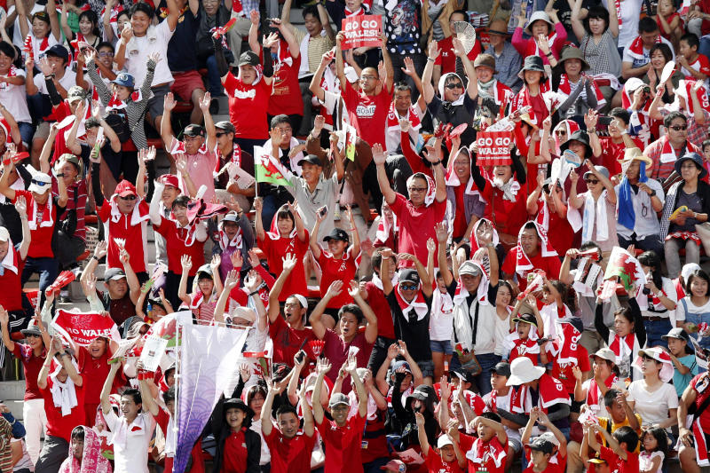 Spectators watch Wales' team training in Kitakyushu, western Japan, Monday, Sept. 16, 2019, ahead of the Rugby World Cup in Japan. (Kyodo News via AP)